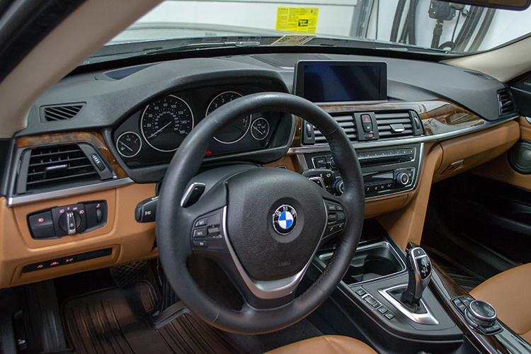 Brown interior of a BMW 335i GT, detailed and protected, looks brand new off of the lot