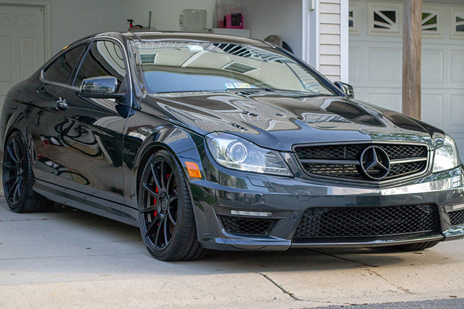 Front passenger side of a clean black c63 coupe